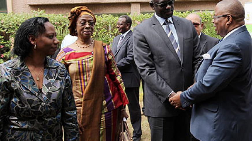 <p>Justice minister Johnston Busingye (2R) greets Med Kaggwa, a Commissioner with African Commission for Human and People&rsquo;s Rights as President of the commission Sylvie Kayitesi (L), and President of the African Court of Human and Peoples&rsquo; Rights Sophia Akuffo, look on last week. John Mbanda.</p>