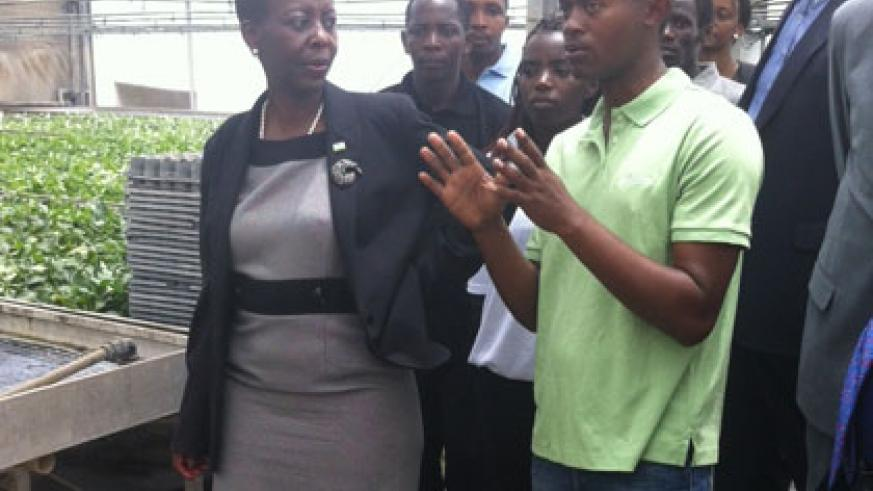 One of the Rwandan students demonstrates to Minister Mushikiwabo during her meeting with Rwandans studying agriculture in Israel. (Courtesy)