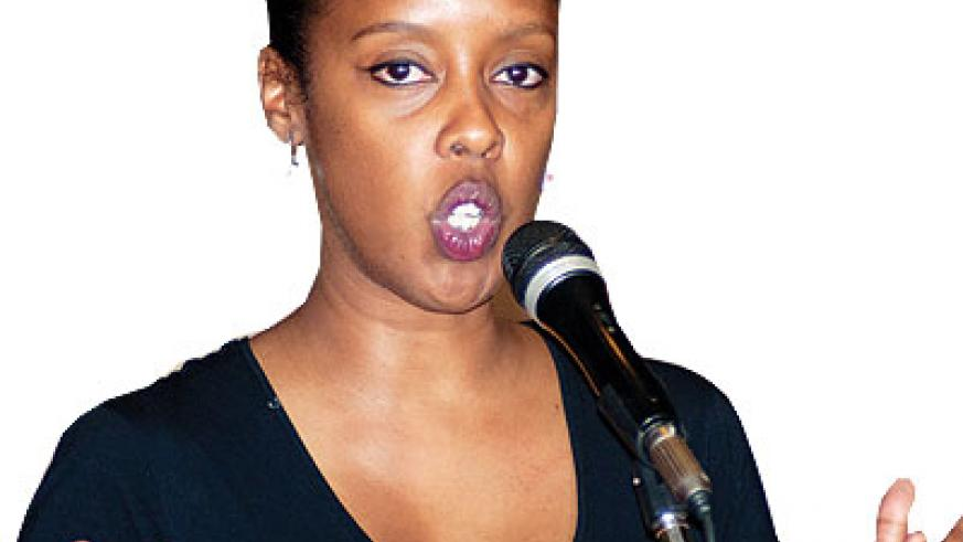 Spoken Word co-founder, Diana Mpyisi, adresses the crowd