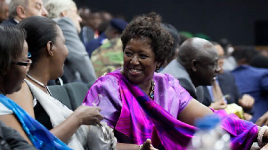 Health minister Agnes Binagwaho(centre), shares a light moment with East African Community Affairs new minister Amb. Valentine Rugwabiza at the swearing in ceremony of Cabinet yesterday.  Timothy Kisambira.