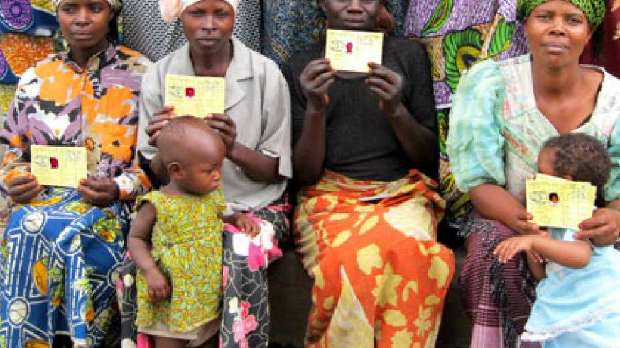 Mothers display their Mutuelle de Sante cards. Experts attribute Rwanda's performance to provision of health care to all citizens. File.