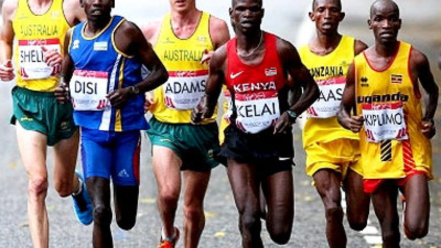 Michael Shelley of Australia, Dieudonne Disi, Liam Adams of Australia, John Kelai of Kenya, Philip Kiplimo of Uganda compete in the Men's marathon yesterday. Shelley won the race, while Kenya's Stephen Chemlany and Uganda's Kiplimo came in second and third, respectively.  Net photo.