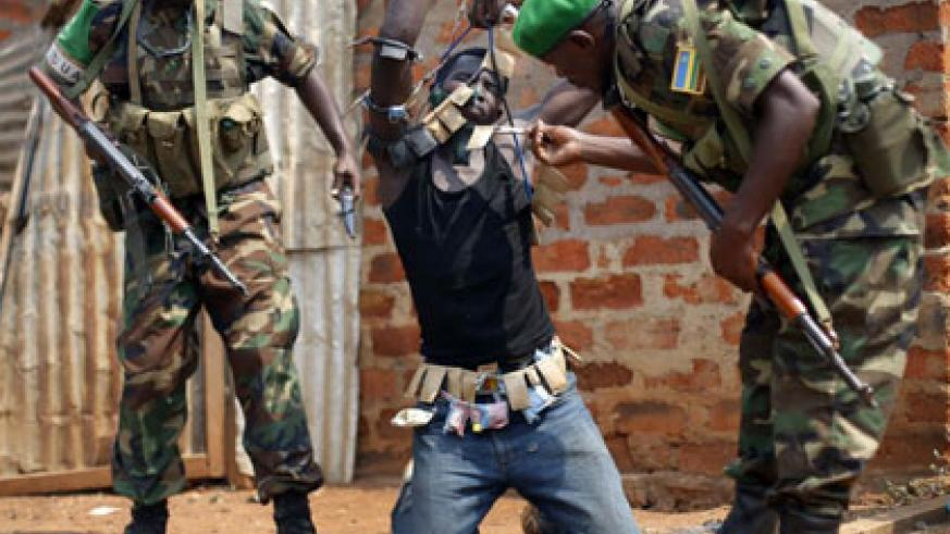 Rwandan peacekeepers in Central African Republic disarm a militiaman earlier this year. Courtesy.