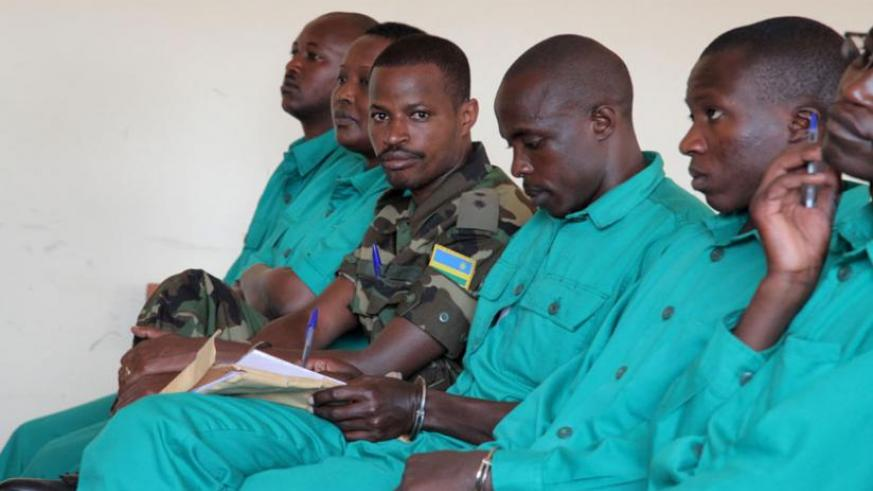 Joel Mutabazi (in military fatigue) and his co-accused in court. (John Mbanda)