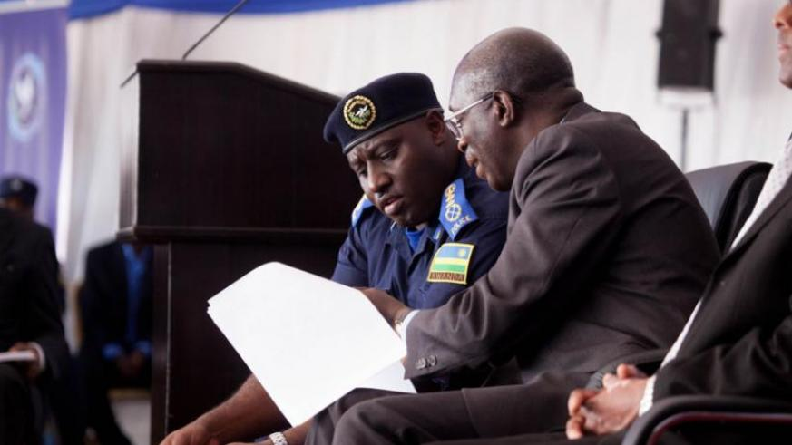 IGP Emmanuel K. Gasana compares notes with Prime Minister Anastase Murekezi at the launch of the Police Book yesterday. (Timothy Kisambira)