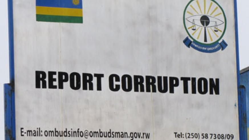 An anti corruption sign post. The new law was enacted will make corruption a very risky venture. File.