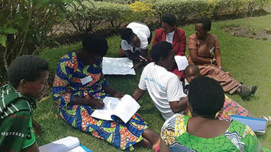 Some of the women, who attended the training in Rulindo District last week, discuss what they studied. The New Times / Peterson Tumwebaze.