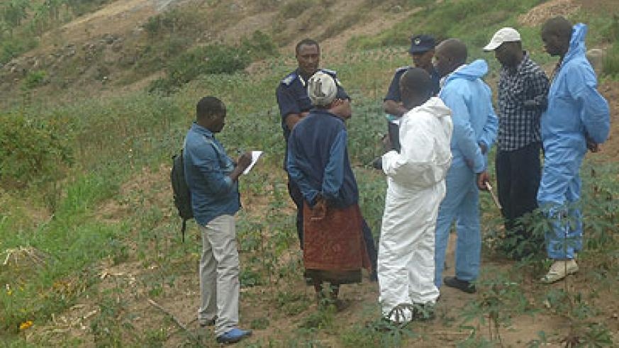 Detectives and forensic experts cordon off the scene of crime on Saturday as  investigations into the murders continue.  Courtesy.