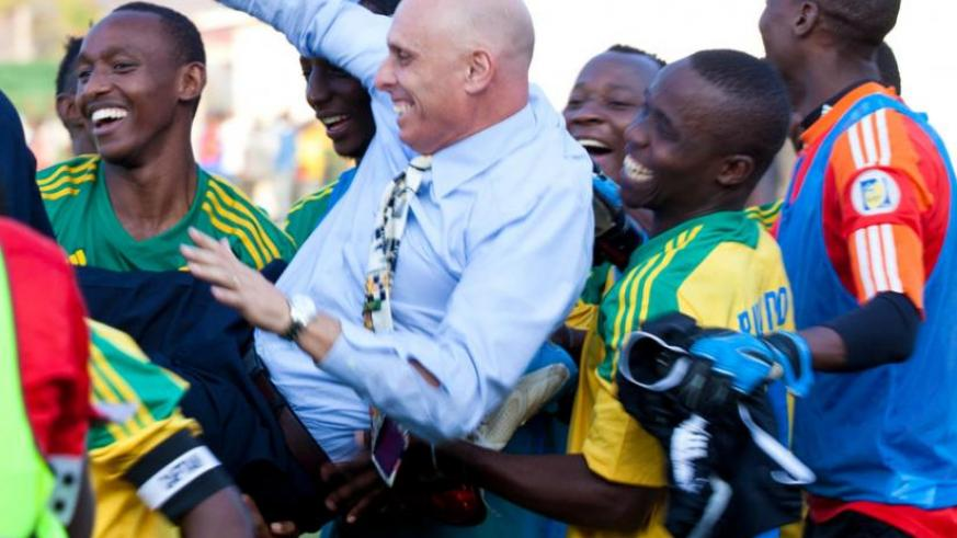 Head coach Stephen Constantine is lifted shoulder high by players after Rwanda defeated Congo on Saturday. (Timothy Kisambira)