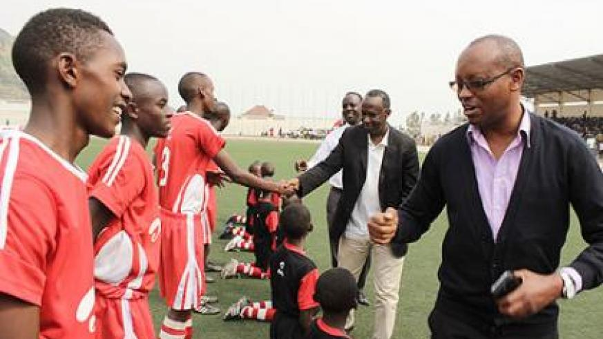 FERWAFA Vice president Vedaste Kayiranga greets Kayonza FTC squad before the final match.