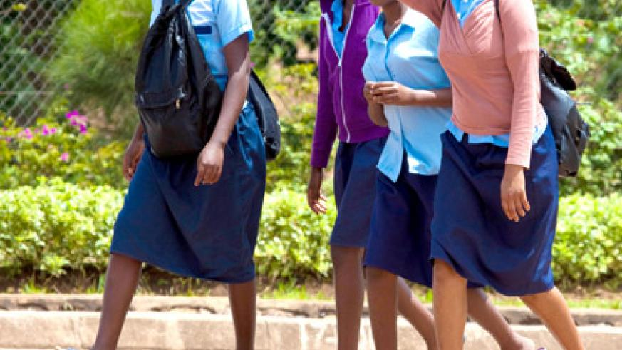 Unlike in the past where students were discouraged from putting on shoes, today anyone barefooted will look out of place. (Timothy Kisambira)