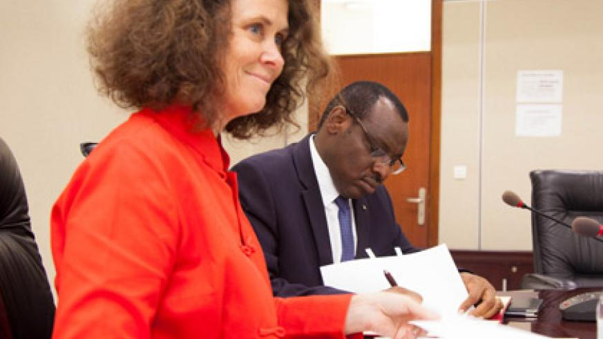 Minister Gatete (R) and Turk sign the SGBV financial agreement in Kigali yesterday. (Timothy Kisambira)