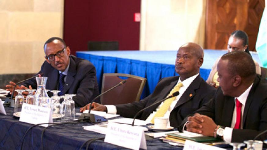 Kagame speaks at the meeting between the US Chamber of Commerce and East African Community leaders in Washington, D.C yesterday. Looking on are his counterparts Yoweri Museveni of Uganda (centre) and Uhuru Kenyatta of Kenya. (Village Urugwiro)