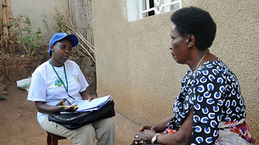 A census enumerator talks to a resident in Remera during the last national census. File.