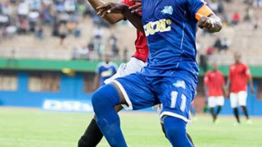 Rayon Sports captain Fuadi Ndayisaba shields the ball against an Adama City defender yesterday at Amahoro stadium. Ndayisaba was named Man of the Match. T. Kisambira.