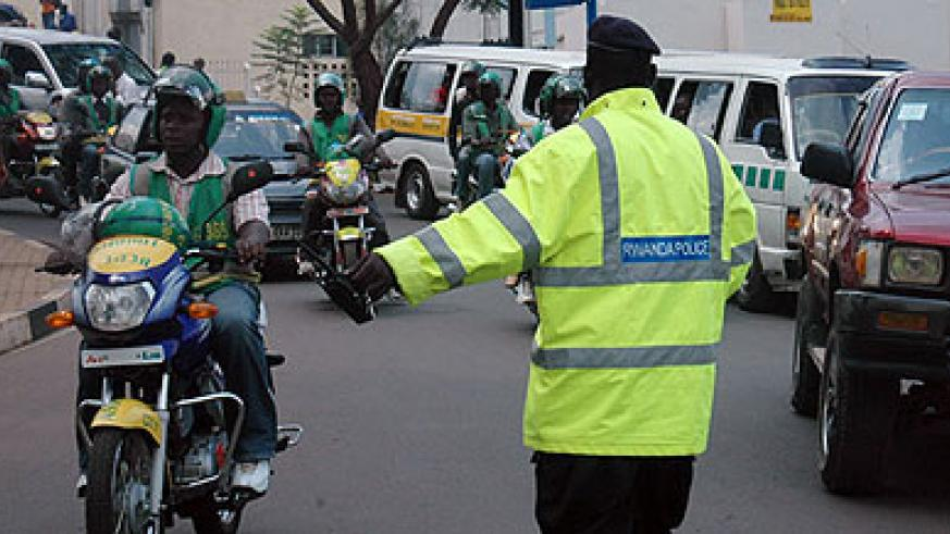 A traffic officer guides motorists in Kigali. New traffic penalties are envisaged to curtail accidents. File.