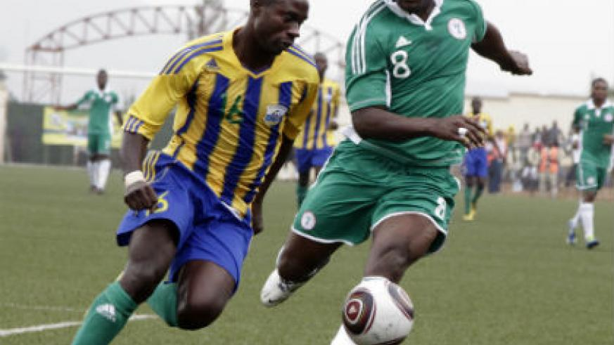 Amavubi defender Mbuyu Twite beats Nigeria striker Yakubu Aiyegbeni to the ball during a previous meeting between the two teams in 2012 in Kigali. (File photo)