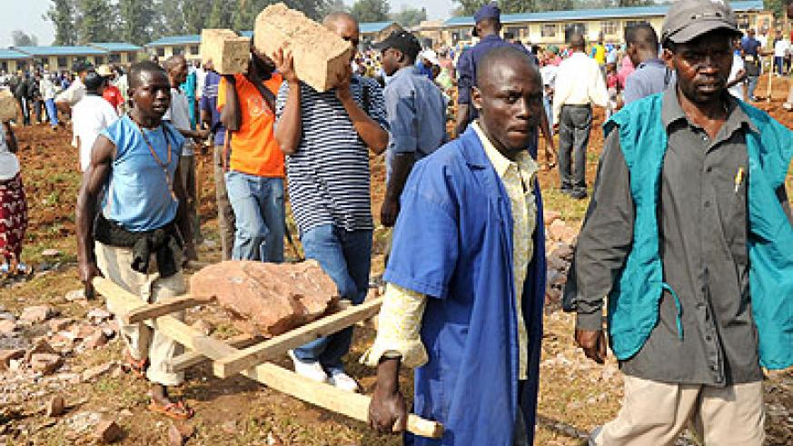 Residents of Kanombe construct a school during a past Umuganda exercise. File
