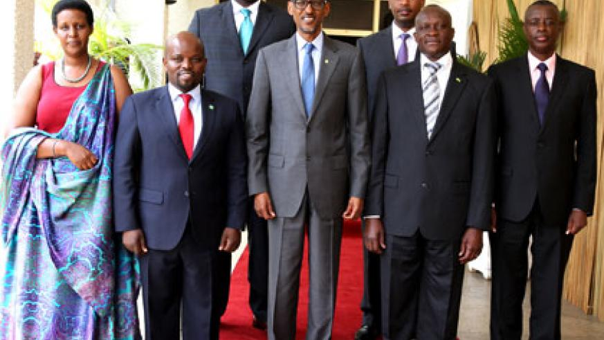 <p>President Kagame in a group photo with ministers who took oath of office at Parliament yesterday. On his left are Joseph Habineza and James Kabarebe. On the right are Jean Philbert Nsengimana and Oda Gasinzigwa and back row left is Amb. Eug&egrave;ne-Richard Gasana  and Albert Nsengiyumva. (Village Urugwiro)</p>