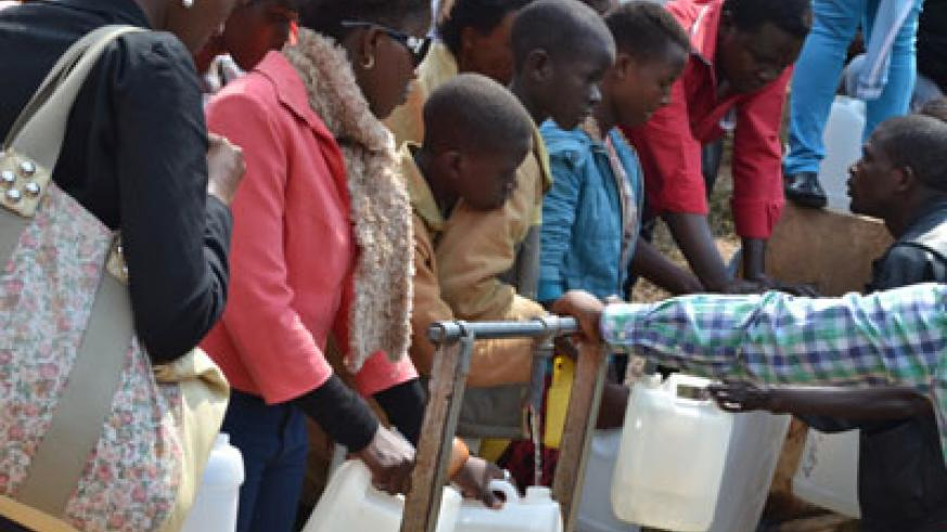 Water of Life: While thousands were busy in mass, others queued to fetch from Mary's Fountain in Kibeho. File.