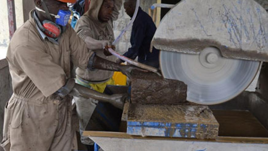 Some members of the Kohia cooperative make tiles from volcanic rocks. Jean d'Amour Mbonyinshuti.