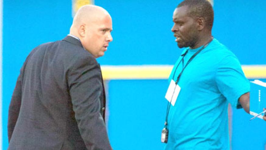Rayon Sports coach Jean-François Lusciuto (L) shares a word with his assistant Sosthène Habimana during the group game against Azam. (Timothy Kisambira)