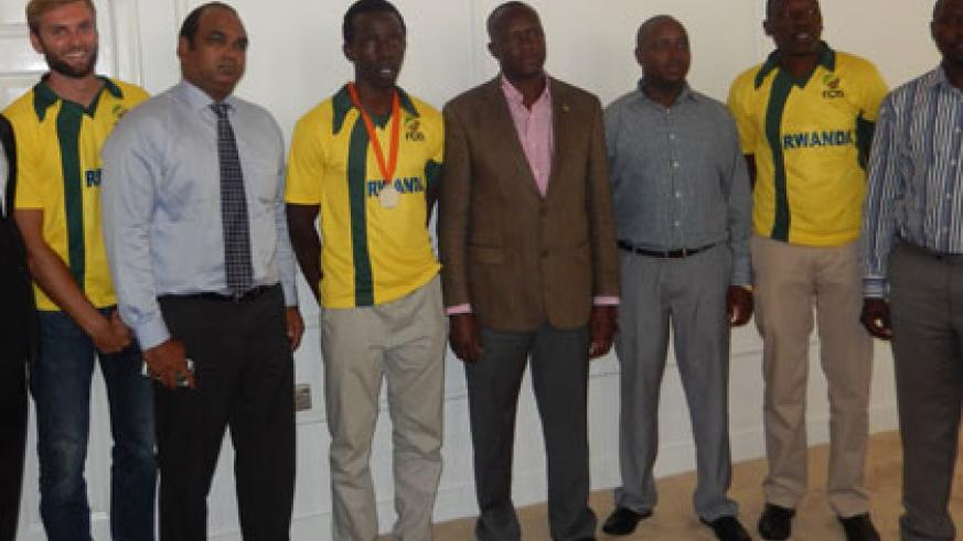 Minister Habineza (C) with the RCA delegation at the former's office at Amahoro Stadium, yesterday. (Pontian Kabeera)