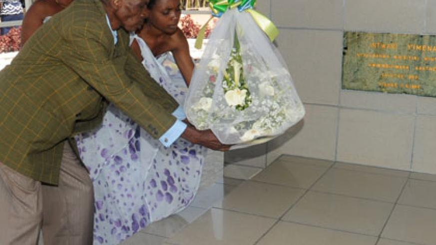 Relatives of former premier Agathe Uwilingiyimana lay a wreath on her tomb during a past Heroes Day. (John Mbanda)