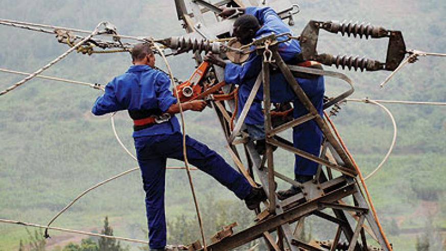 EWSA workers fix a powerline. The government is promoting infrastructure development to spur economic growth. File.