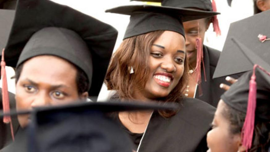 Female graduates celebrate after being confered upon yesterday. Timothy Kisambira.