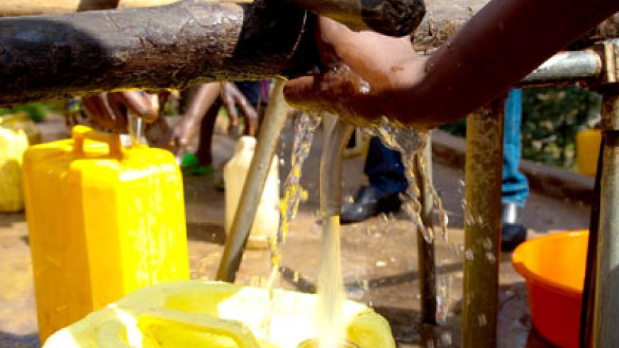 People draw water from a public tap. WSC is seeking to recover billions of francs from consumers. File.