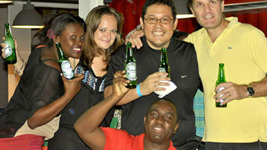 Bralirwa officials having a good time at the houseparty. All  photos by Nayituriki Seraphin
