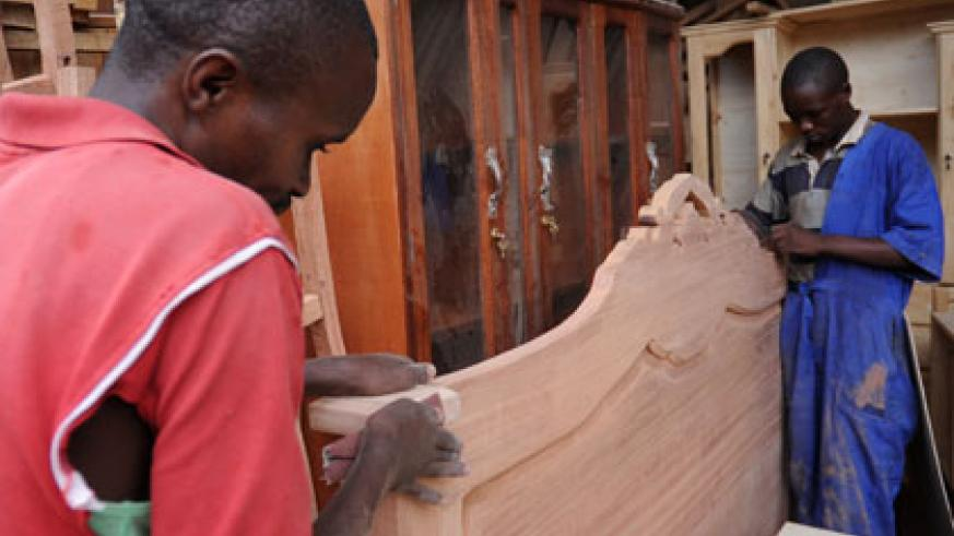Youths in a carpentry business at Gaculiro. BDF has pledged to facilitate rural communities with access to financial services. John Mbanda.