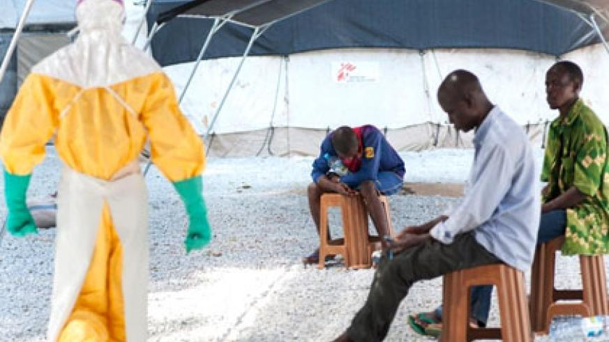 A health official visits to check on suspected Ebola patients in Liberia. Net photo.