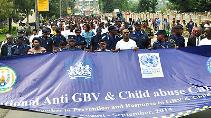 Police hold a banner at the launch of anti-GBV campaign in Musanze on Monday. Courtesy