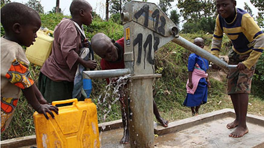 Children fetch water at a public borehole. Over 11% of city dwellers don't have access to safe water. File.