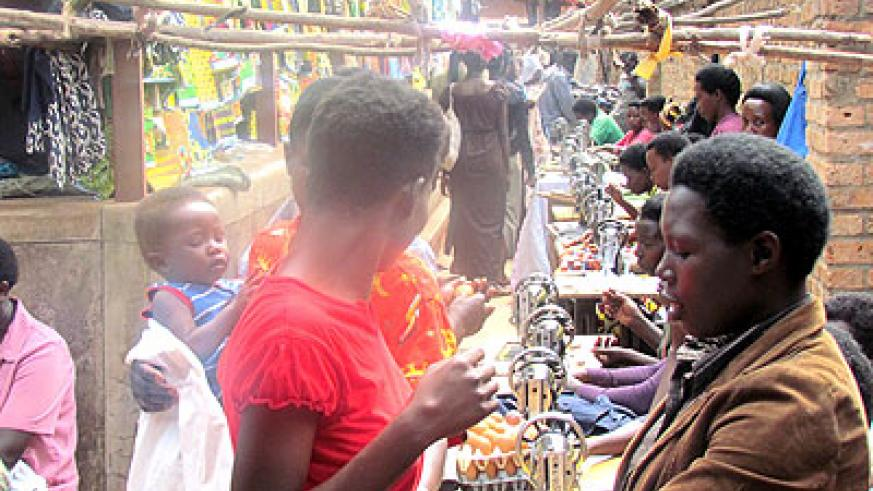 The girls sew clothes in one of the public markets in Ngoma District.  They are currently operating in different markets in the district. Stephen Rwembeho.