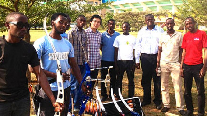 Axiom Network group offcials pose with the Archery and Shooting federation after donating the sporting equipment. Courtesy