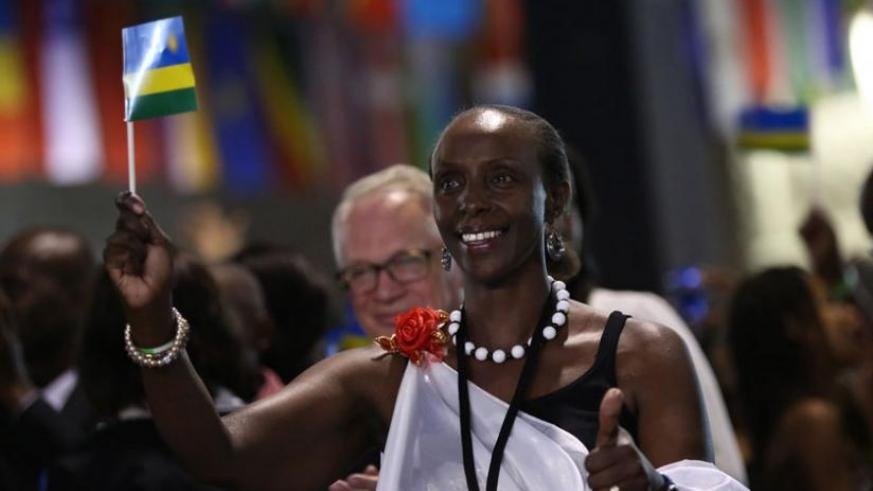 A participant at the Rwanda Day 2013 in Toronto, Canada, proudly waves the National Flag. Atlanta city in the US will host the 2014 version. (File)