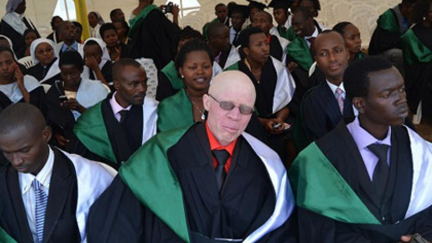 Hakizimana with colleagues during last week's graduation. He has defied stigma and is now a fresh graduate from the College of Education. (Jean d'Amour Mbonyinshuti)