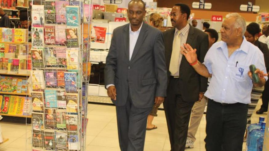 Amb. Sezibera (left) and Arusha mayor Gaudence Lyimo on a guided tour of Nakumatt's 50th store in Arusha by Shah (right). Courtesy.