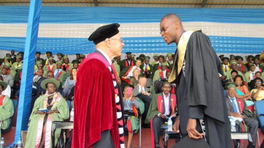 Ambroise Jean-Louis gets the confidence vote of Dr O'Neal, during the University of Rwanda's maiden graduation last week. (Timothy Kisambira)
