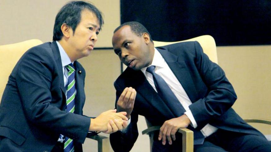 RDB chief executive Francis Gatare (R) chats with Japanese parliamentary vice minister for Foreign Affairs Hirotaka Ishihara during a consultative meeting on investments in Kigali yesterday. (John Mbanda)