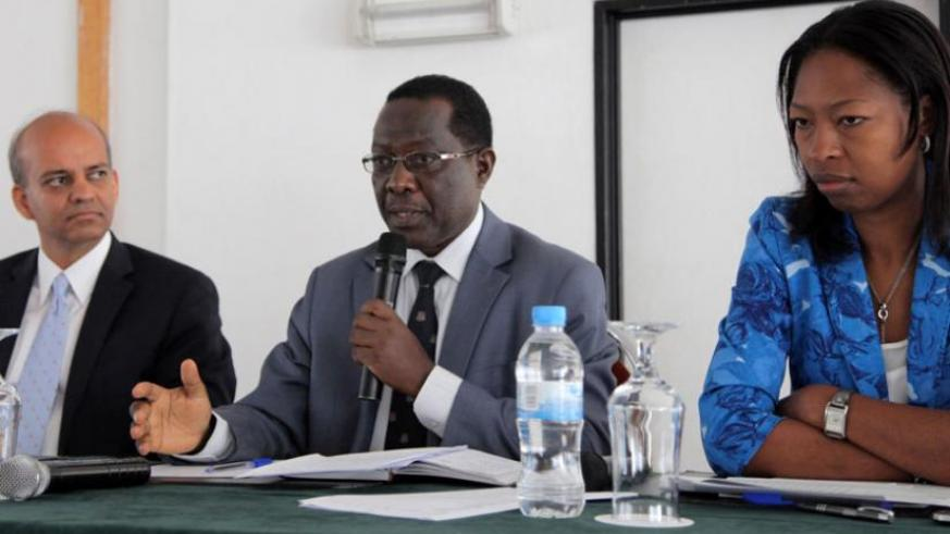 Geology and Mines chief Biryabarema (C) addresses participants during the meeting on mining in Kigali yesterday. Looking on are Apurva Sanghi of World Bank (L) and Amina Rwankunda of the Ministry of Finance and Economic Planning. (John Mbanda)