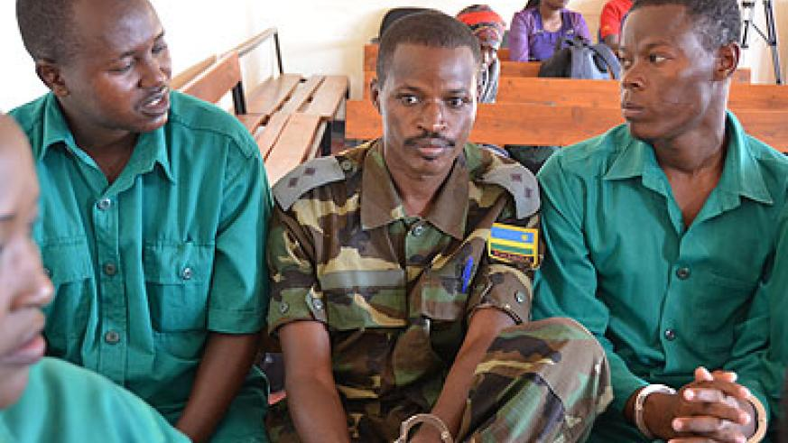 Lt. Joel Mutabazi and co-accused during the trial at the Military High Court yesterday.  (File)