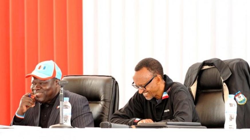 President Kagame and party vice chairperson Christophe Bazivamo (L) at the Rwanda Patriotic Front Political Bureau meeting at Petit Stade in Remera in Kigali yesterday. (Village Urugwiro)