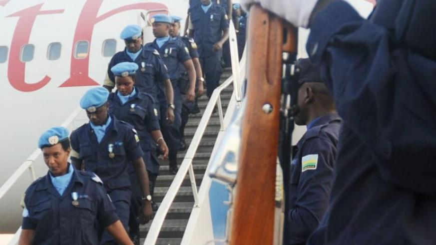 A Rwanda National Police contigent, that included women officers, arrive at Kigali International Airport from a tour of duty in Haiti last year. (File)