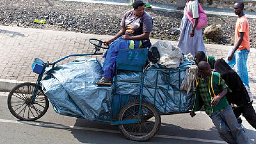 A business woman is helped to transport her mrachandise to Goma market across the DRC/Rwanda border.