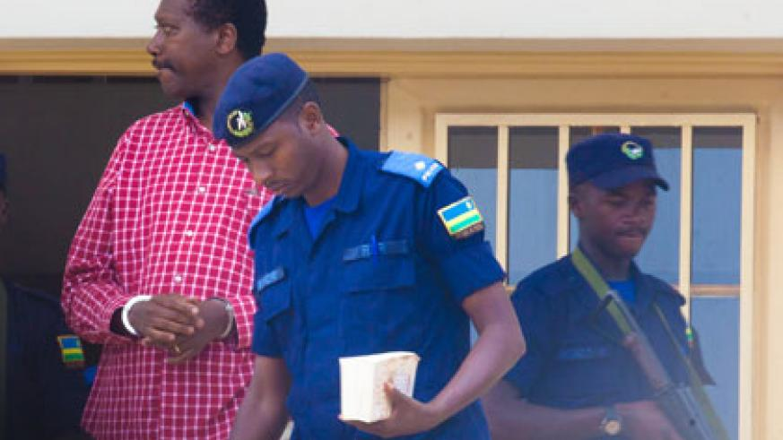Kabuye is escorted out of the court on Monday. Timothy Kisambira.