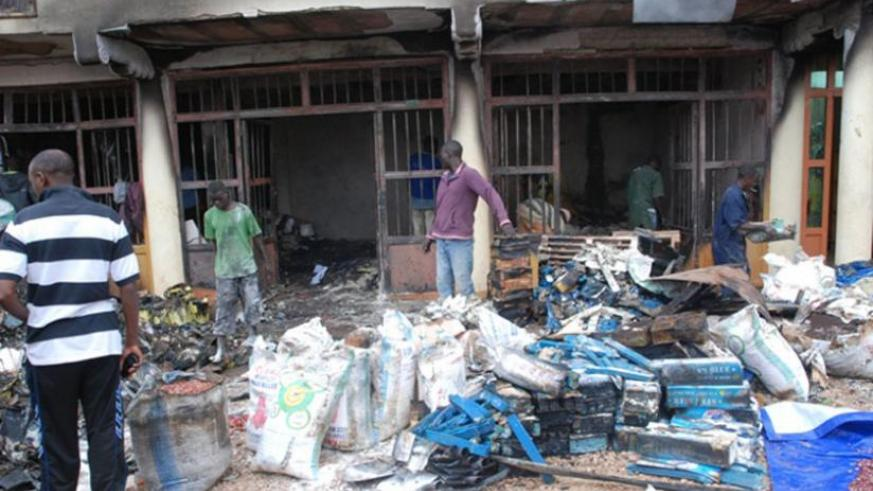 Traders try to salvage some of the property burnt in the late night fire yesterday. (Jean Pierre Bucyensenge)